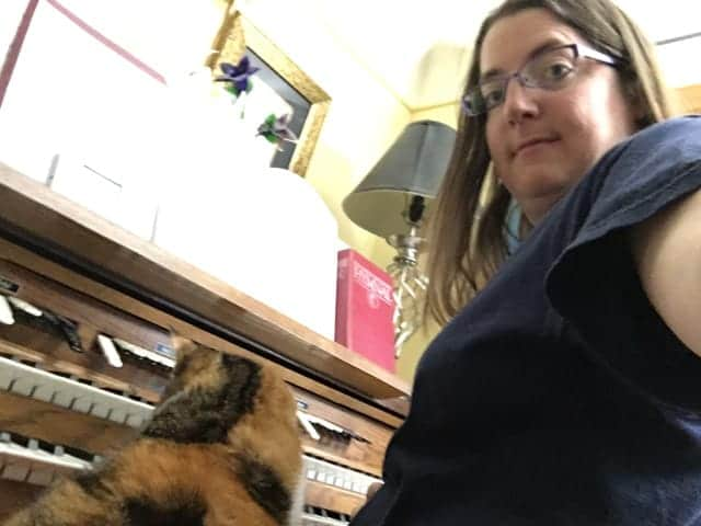 Heidi with Kilala on the organ bench