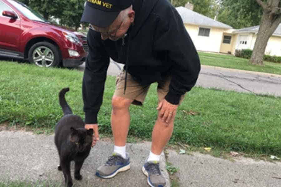 My dad petting Midnight, one of the outdoor cats